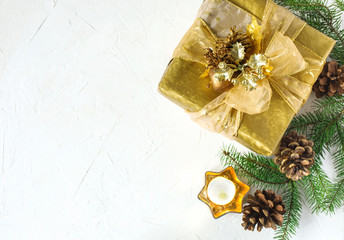 Christmas flatlay background. Christmas gift box and fir branches on white background