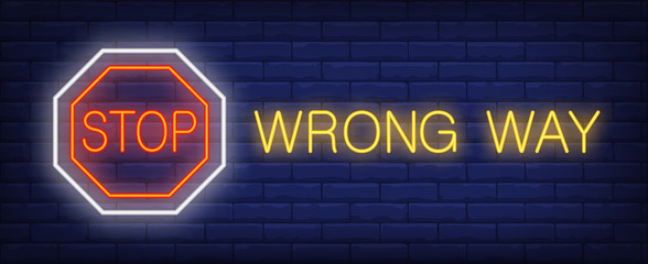 Stop, wrong way neon text with octagon sign. Caution design. Night bright neon sign, colorful billboard, light banner. Vector illustration in neon style.