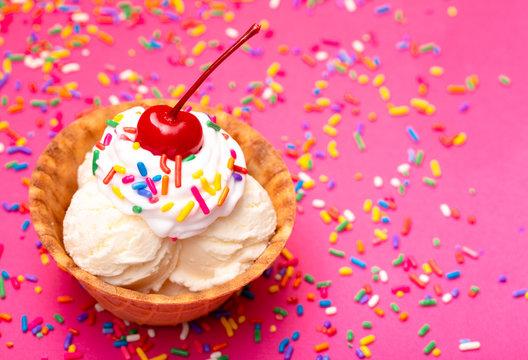 Vanilla Ice Cream in a Waffle Cone Bowl wiht a Cherry on Top