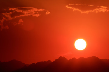 Sunset orange and red colors landscape, sea and sun with deep sky background. Red Sea, Egypt, Africa. Evening sunset view with clouds sky. Vacation at summer time. Sunrise morning beauty of nature