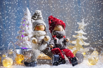 Christmas scence. Children (toys) on sleds and two funny snowmen.Christmas background