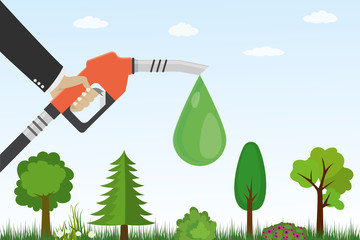 Gasoline pump with drop and green plants, grass,trees..Ecological gas station.
