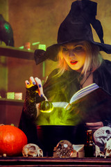 Image of witch blonde in black hat with book brewing potion in pot with green steam