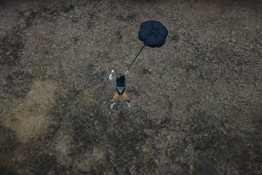 Base jumper in free fall before the opening of the parachute. Basejumping.