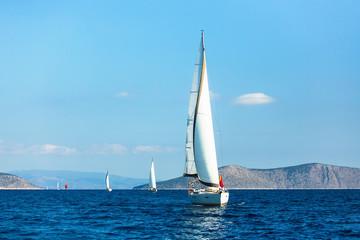 Sailing luxury boats during yacht regatta in the Aegean sea, Greece.