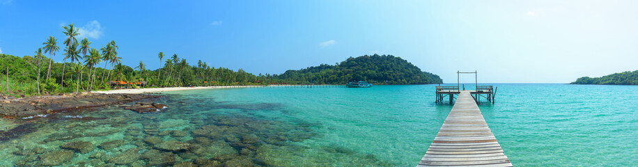 Panoramic beautiful tropical island and long wooden bridge go to the sea, Thailand.
