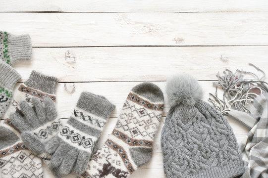 Warm woolen knitwear on wood