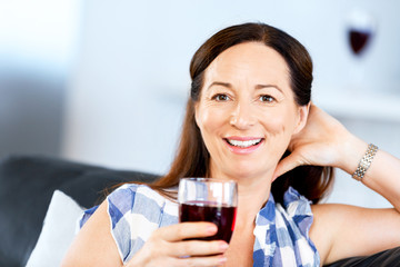 Woman with holding a glass of wine indoors