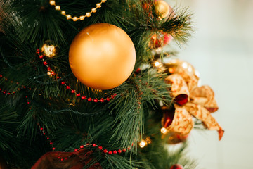 Background with Christmas tree decoration and gold garland.
