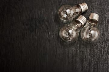 light bulbs on a wood background