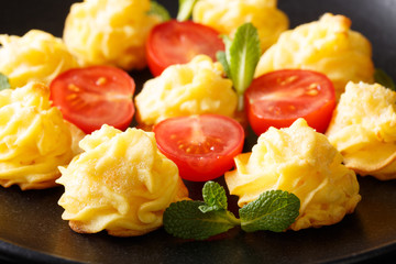 Duchess potatoes served with mint and tomatoes closeup on a plate. horizontal Wall mural