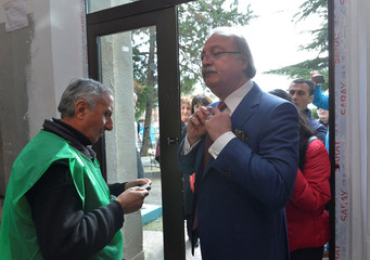 Presidential candidate Vashadze visits a polling station during the presidential election in Kutaisi