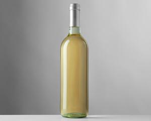 Bottle of white wine on grey background