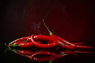 Canvas Prints Hot chili peppers Red hot chili peppers on dark color background