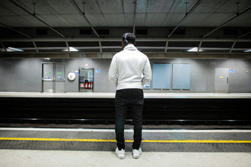 Man waiting at a subway station