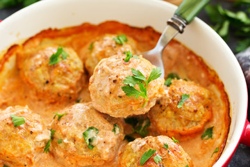 Meatballs in a creamy tomato sauce.