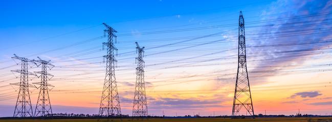 Fototapeta high-voltage power lines at sunset,high voltage electric transmission tower obraz