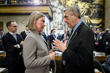 EU Foreign Minister Federica Mogherini speaks with United Nations High Commissioner for Refugees Filippo Grandi during the United Nations Conference on Afghanistan at the UN Offices in Geneva