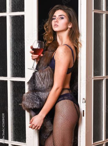 b9b1a6fa9ec Woman seductive appearance. Woman seductive model wear luxury fur and elite  lingerie. Confident in her magnetism. Seduction art concept.