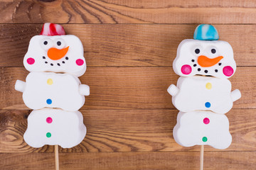 Sweet snowmen on stick, place for text