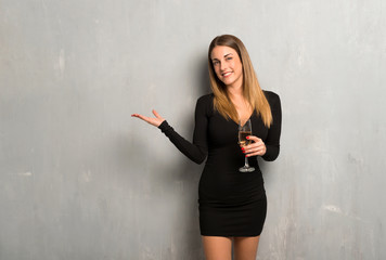 Woman with champagne celebrating new year 2019 pointing back with the index finger