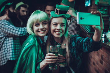 Friends doing selfie at Saint Patrick's Day at pub