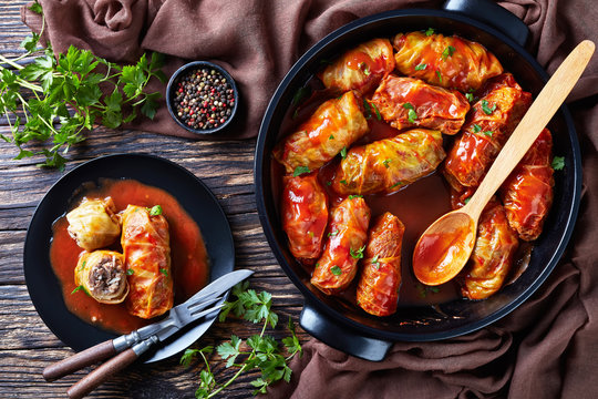 cabbage rolls on a black plate
