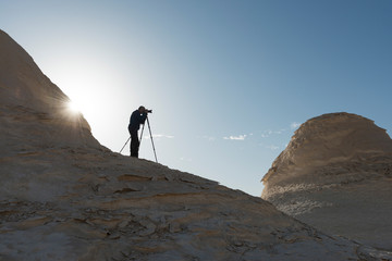Silhouette of landscape photographer at the white desert