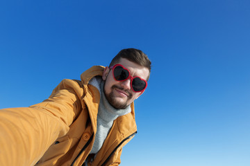 Man taking selfie. Winter time.
