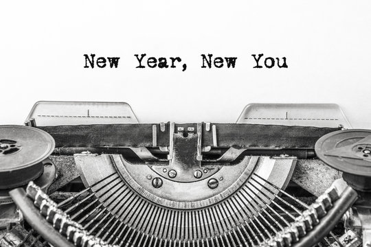New Year, New You! Text is typed on a vintage typewriter on a white background. Close-up.