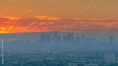 Fotobehang Epic red sunrise over city of Los Angeles , zoom out from downtown skyline. 4K UHD Timelapse.