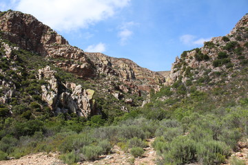 Gorge, surrounded by steep rocky mountains on either side.