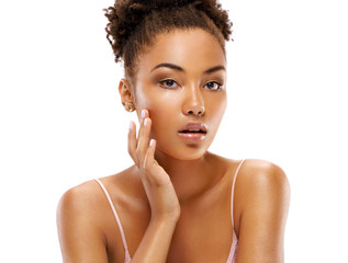 Attractive girl with perfect skin, touching her face. Photo of african girl on white background. Beauty & Skin care concept