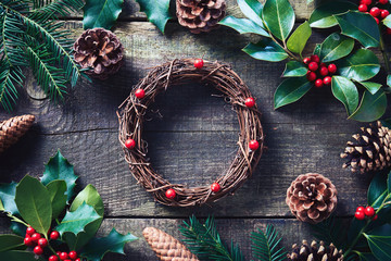 Wall Mural - Making Christmas wreath using fresh and all natural materials