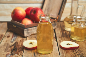 Apple cider vinegar. Bottle of apple organic vinegar