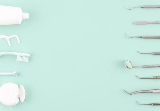 Dentist tools. Teethcare, dental health concept. Light blue background top view copy space flat lay. Teeth care fresh breath
