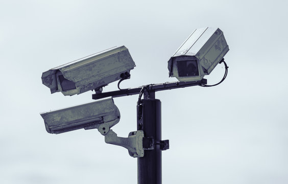 Rustic urban city surveillance cctv video monitoring cameras, spying on civilians. big brother is watching you.