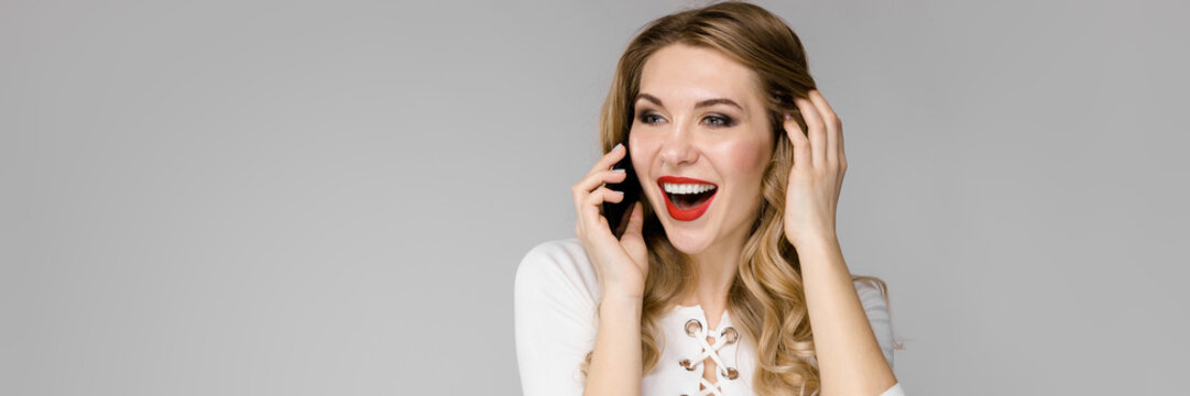 Young beautiful girl is calling by phone