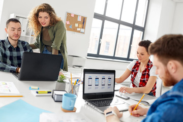 business, technology and people concept - creative team or designers working on user interface at office
