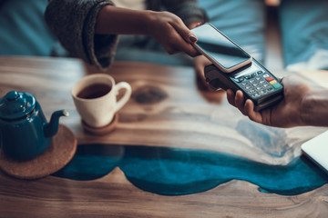 Horizontal image of contactless payment with smartphone