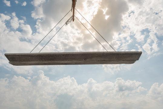 Crane hook lifting concrete slap with cloudscape, Construction equipment crane and cargo lifting concrete plate