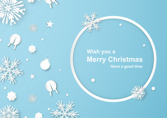 Christmas decoration on blue background in paper cut and craft with snowflake.