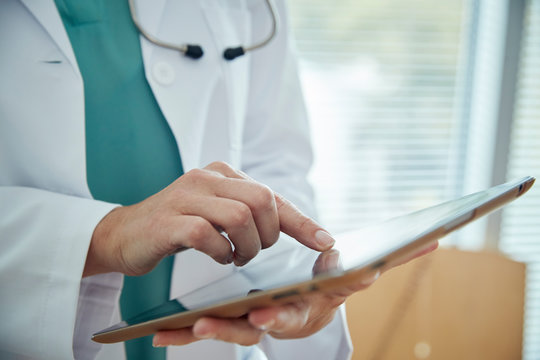 Doctor touching a tablet