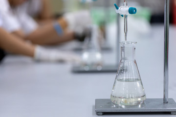 Titration technique in the laboratory.