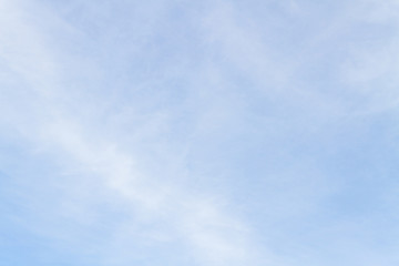 Blue sky with white porous clouds in summer