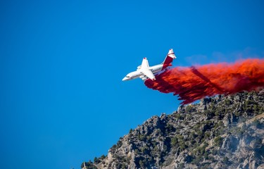 Slurry bomber fights wildfires.  Aerial Firefighting in Utah