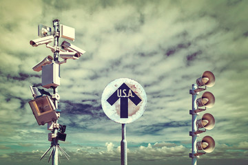 Surveillance cameras with vintage USA direction sign