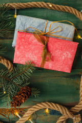 Pink and blue gift with Christmas lights from above
