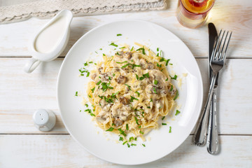 Spaghetti with mushrooms in cream sauce