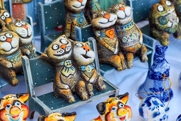 Lovely pair of the ceramic cats sitting on the bench